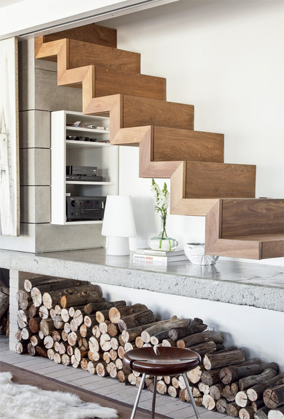 Beautiful wooden stairs with space underneath for media tech, lamp and vase